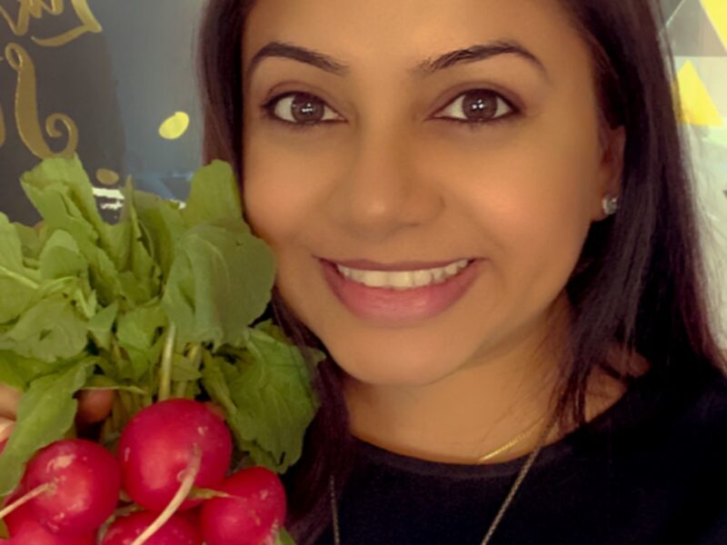 Photo of Pooja Adhyaru holding a radish